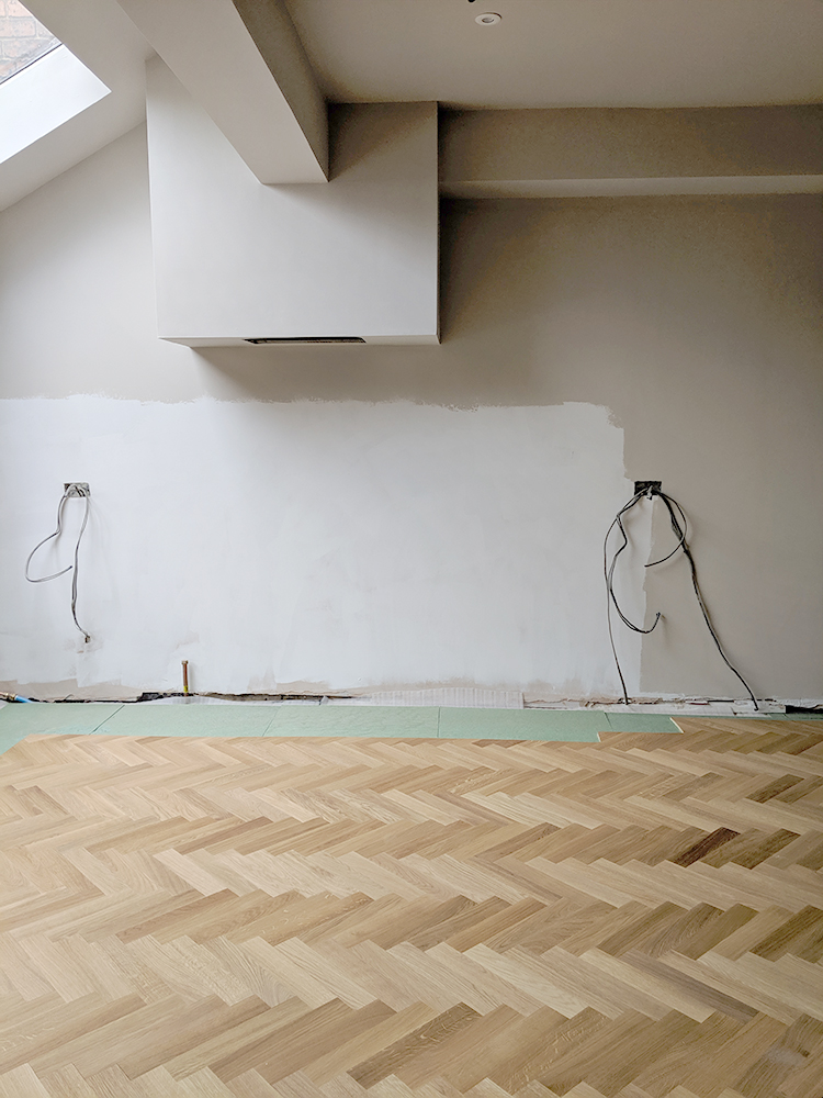 Laying parquet around kitchen units